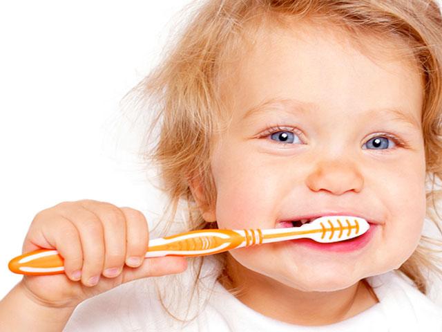 baby brushing teeth, dr. dennis dunne, DDS